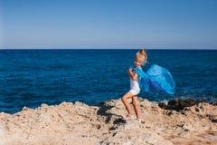 Beautiful girl on the seashore. Beautiful girl posing on the rocky seashore Royalty Free Stock Photo