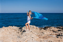 Beautiful girl on the seashore. Beautiful girl posing on the rocky seashore Stock Image