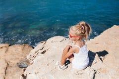 Beautiful girl on the seashore. Beautiful girl posing on the rocky seashore Royalty Free Stock Image