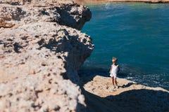 Beautiful girl on the seashore. Beautiful girl posing on the rocky seashore Stock Photos