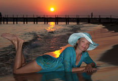 Beautiful girl on the seashore at sunset Royalty Free Stock Images