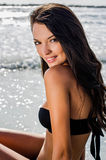 Beautiful girl at seaside smiling Stock Images