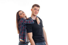 Beautiful girl sends kiss and hugs a young handsome guy who is smiling Stock Photo