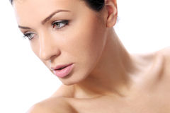 Beautiful girl with serious look and perfect skin Stock Images