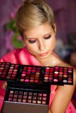 Beautiful girl with set of lipsticks for make-up Royalty Free Stock Photography