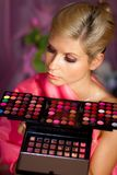 Beautiful girl with set of lipsticks for make-up Royalty Free Stock Photos