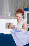 Beautiful girl sewing Royalty Free Stock Photo
