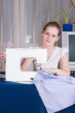 Beautiful girl sewing Royalty Free Stock Images