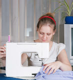 Beautiful girl sewing Stock Image