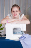 Beautiful girl sewing Stock Photography
