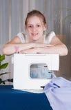 Beautiful girl sewing Stock Photography