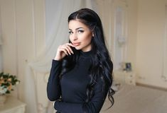 Beautiful girl in a sexy black dress Royalty Free Stock Photography