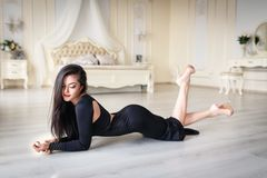 Beautiful girl in a sexy black dress. Beautiful young girl in a sexy black dress Royalty Free Stock Images