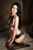 Beautiful girl in a sexy black lingerie Royalty Free Stock Image