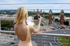 Beautiful girl in sexy dress with open back is photographed panorama of the city Stock Photo