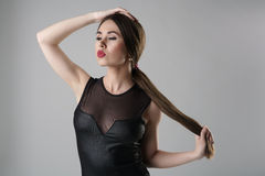 Beautiful girl with sexy lips posing in bodysuit Stock Images