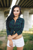Beautiful girl in a sexy shorts outdoor Stock Image