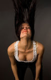 Beautiful girl shaking her head. Isolated on black background Stock Photo