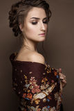 Beautiful girl in a shawl with a braid. Beauty face. Photo was made in studio Stock Photo