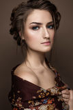 Beautiful girl in a shawl with a braid. Beauty face Stock Photo