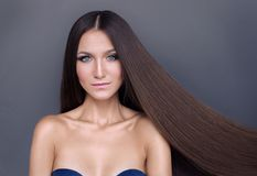 Beautiful girl with shiny long hair. well-groomed blonde hair royalty free stock photos