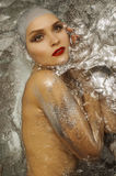 Beautiful girl in shiny water Stock Photos
