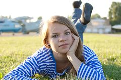 Beautiful girl in the shirt on the grass Royalty Free Stock Image