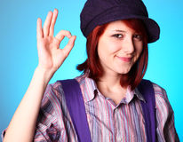 Beautiful girl in shirt and violet cap show OK Royalty Free Stock Image