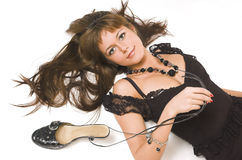 The beautiful girl with shoes lays Stock Photography