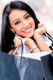 Beautiful girl shopping Stock Images