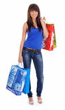 Beautiful girl with shopping bag. Studio isolated shoot Royalty Free Stock Images