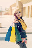 Beautiful girl with shopping bag filter applied instagram style Royalty Free Stock Photos