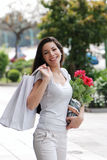 Beautiful girl with a shopping Bag and flower Stock Image