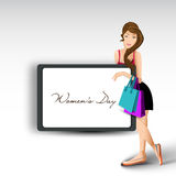 A beautiful girl with shopping bags Stock Image