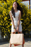 Beautiful girl with shopping bags on the beach Stock Image