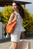 Beautiful girl with shopping bags on the beach Stock Images