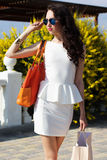Beautiful girl with shopping bags on the beach Royalty Free Stock Photo