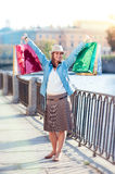 Beautiful girl with shopping bags in the city Stock Images
