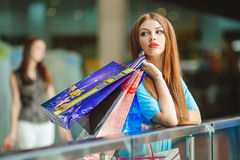 Beautiful girl with shopping bags in a mall Stock Image