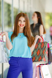 Beautiful girl with shopping bags in a mall Stock Images