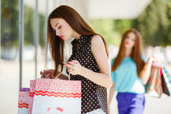 Beautiful girl with shopping bags in a mall Royalty Free Stock Photos