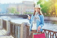 Beautiful girl with shopping bags and mobile phone Stock Photo