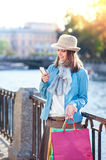 Beautiful girl with shopping bags and mobile phone in the city Royalty Free Stock Photos