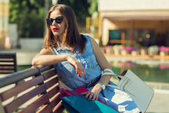 Beautiful girl shopping in the city Royalty Free Stock Photos