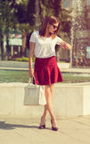 Beautiful girl shopping in the city Stock Images