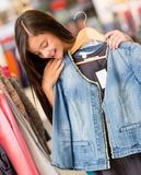 Girl shopping for clothes Royalty Free Stock Photo