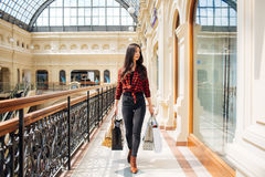 Beautiful girl on shopping in Europe. Very beautiful girl shopping in Europe on vacation Royalty Free Stock Photos