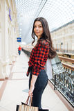 Beautiful girl on shopping in Europe. Very beautiful girl shopping in Europe on vacation Royalty Free Stock Photo
