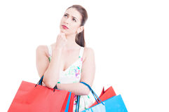 Beautiful girl at shopping feeling pensive or thoughtful Royalty Free Stock Images