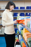 Pretty young woman shopping towels Royalty Free Stock Photos